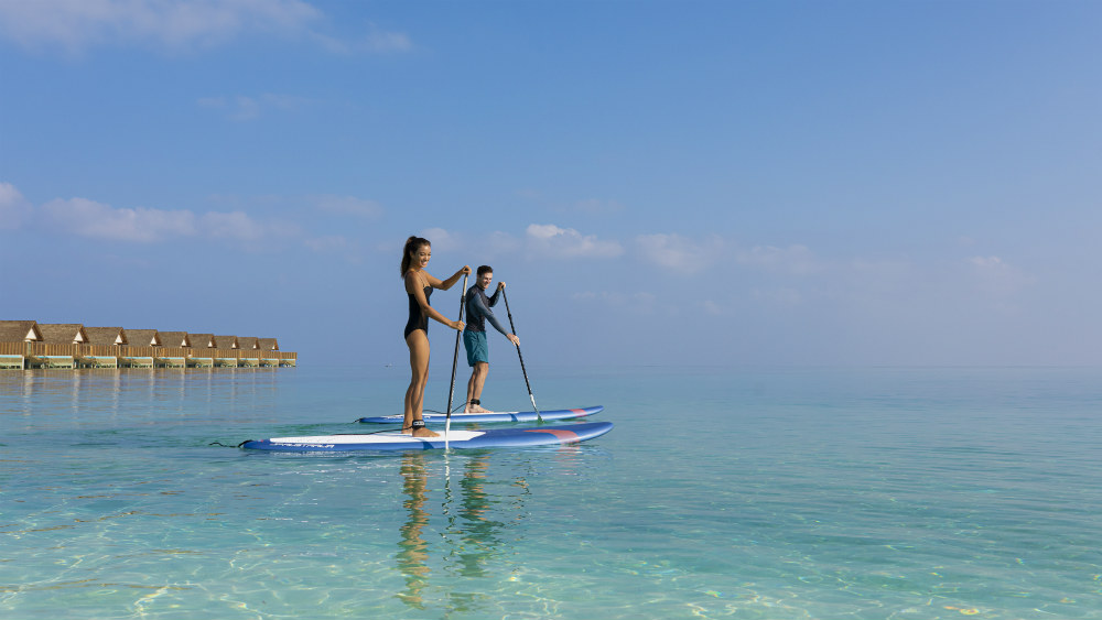 paddle boarding at the Faarufushi Maldives