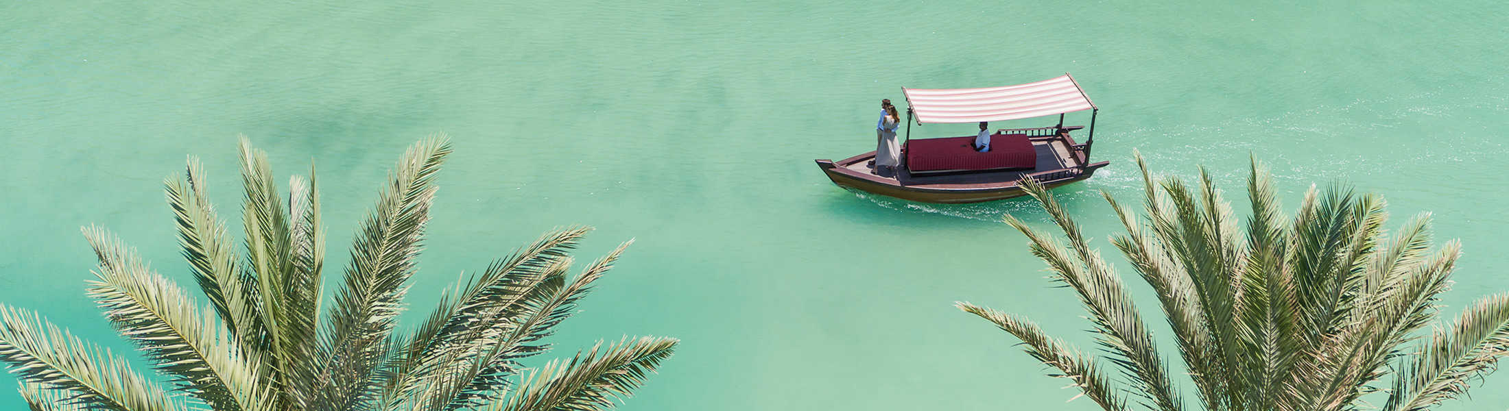 Aerial view of a boat on teh Abra Waterways at Jumeirah Mina A'Salam