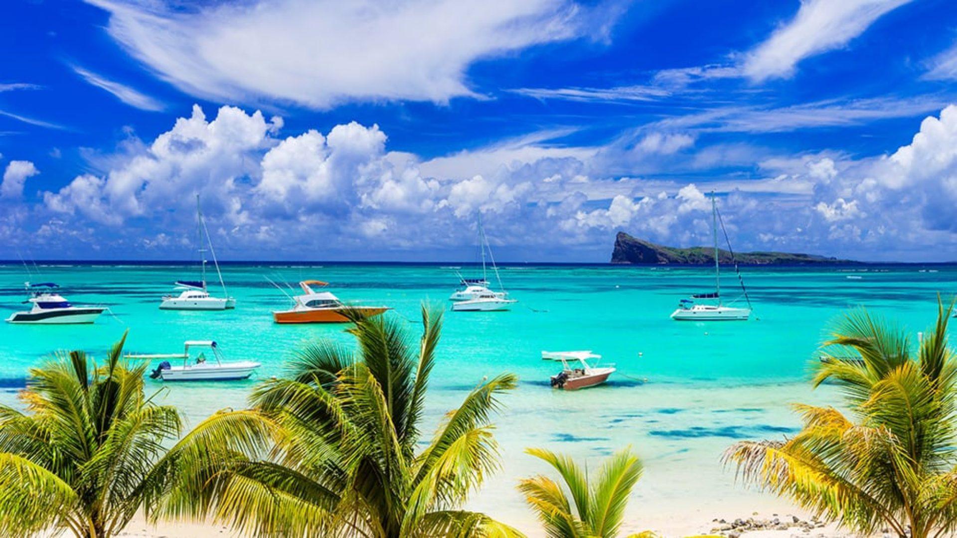 Boats off the coast of Mauritius on a Dubai & Mauritius twin-centre