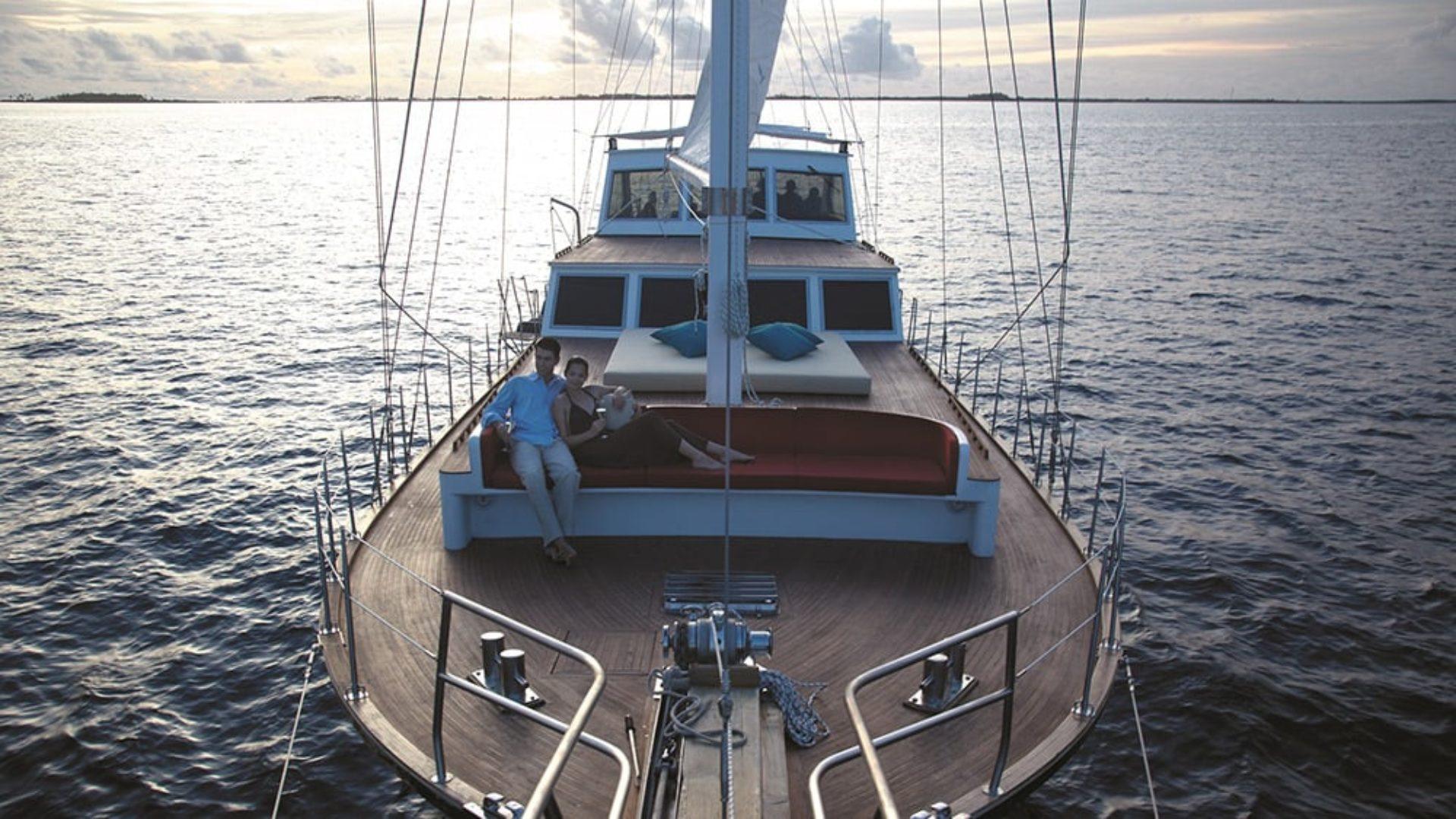 Couple on a sailing cruise at Shangri-La's Villingili Resort