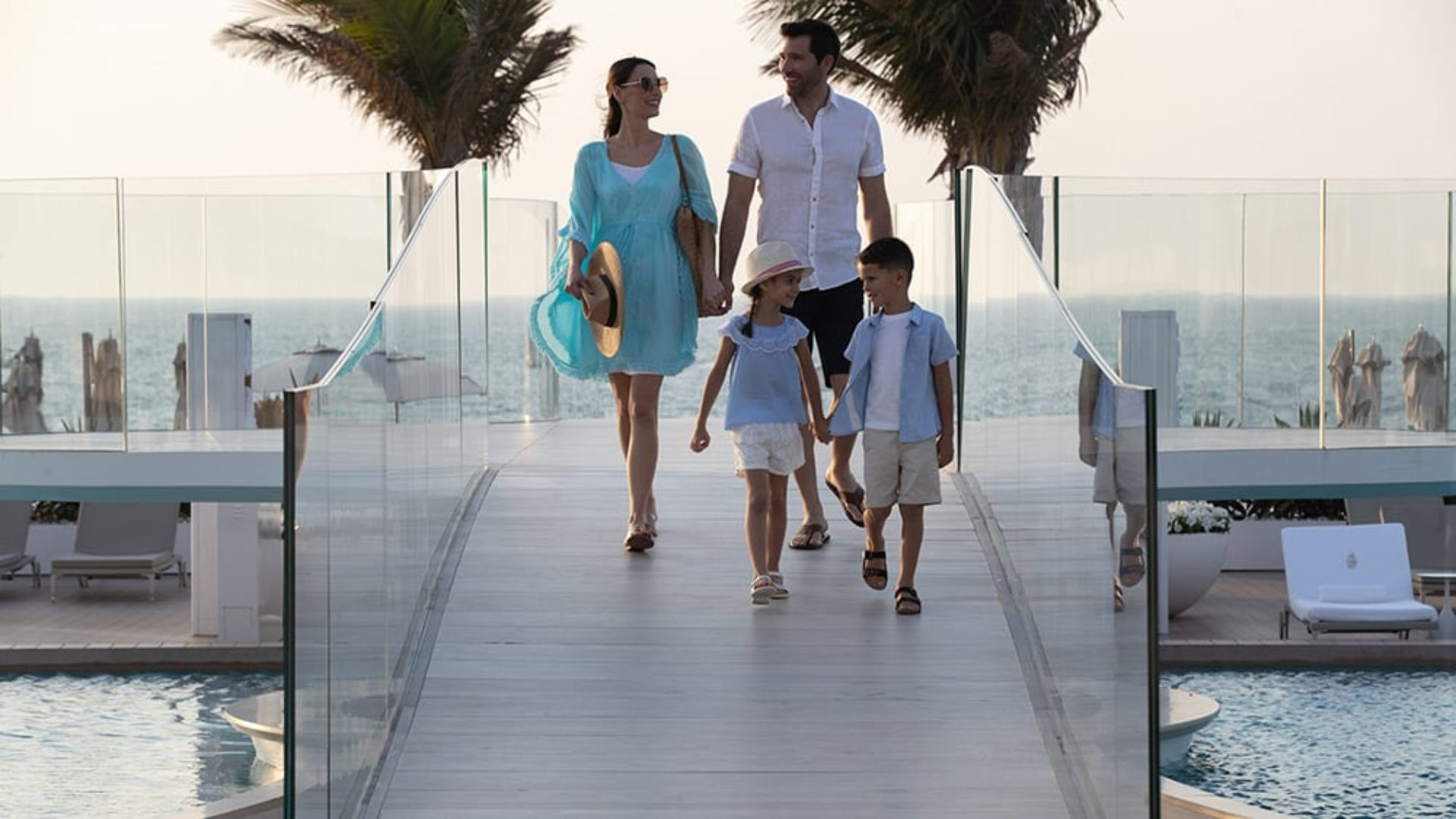 Family crossing the bridge on the pool terrace at the Burj Al Arab