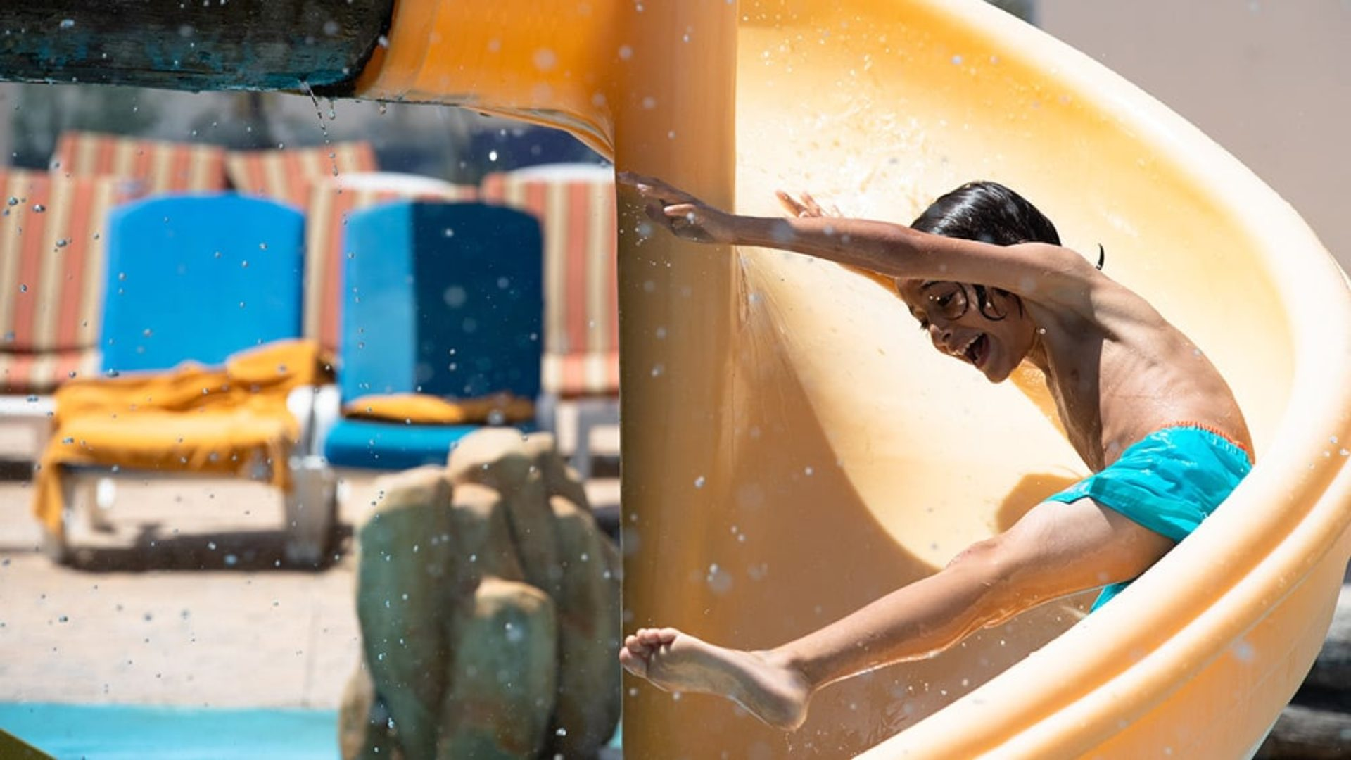 Child on a water slide at Jumeirah Zabeel Saray