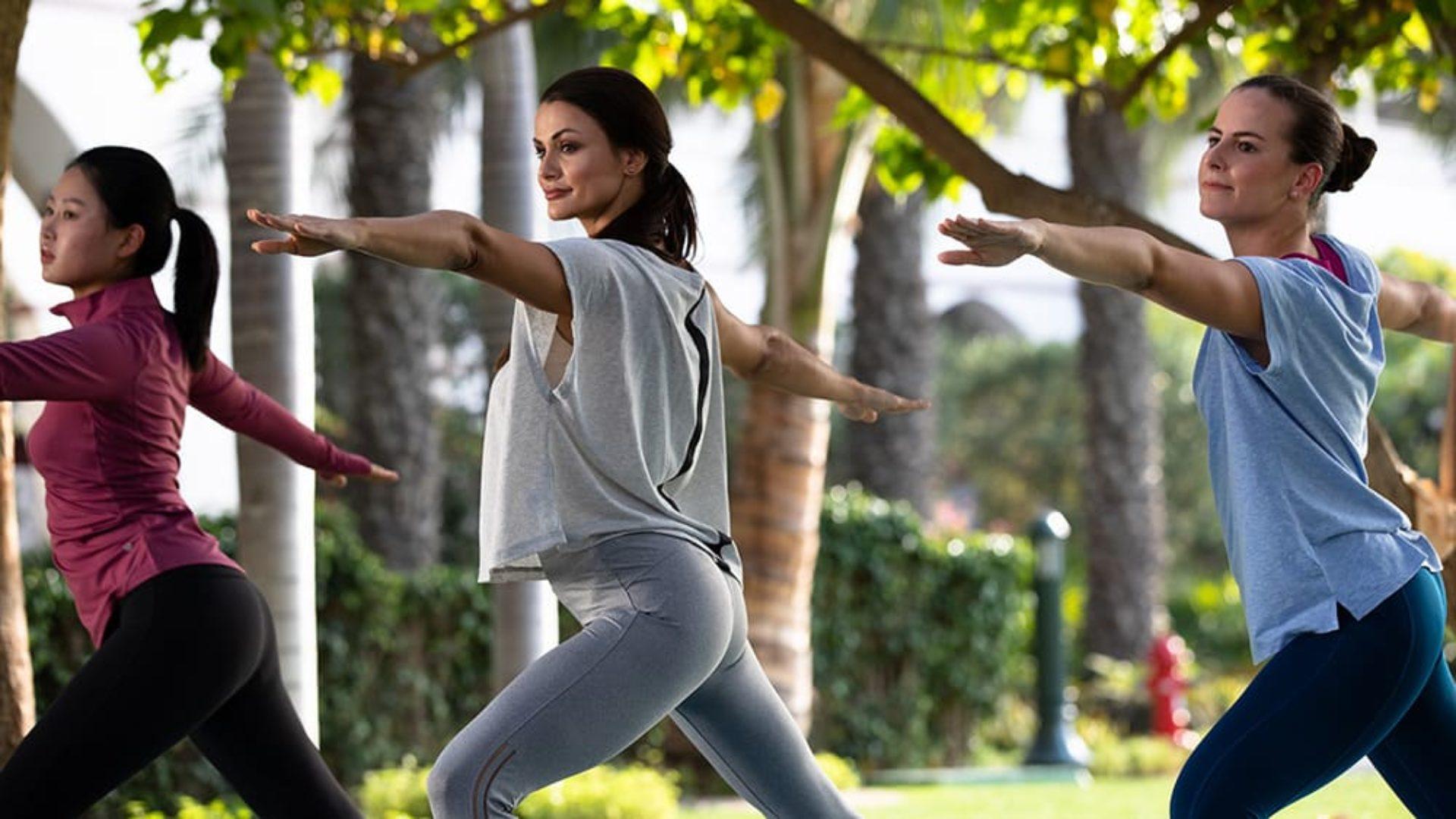 Women doing yoga at Jumeirah Zabeel Saray