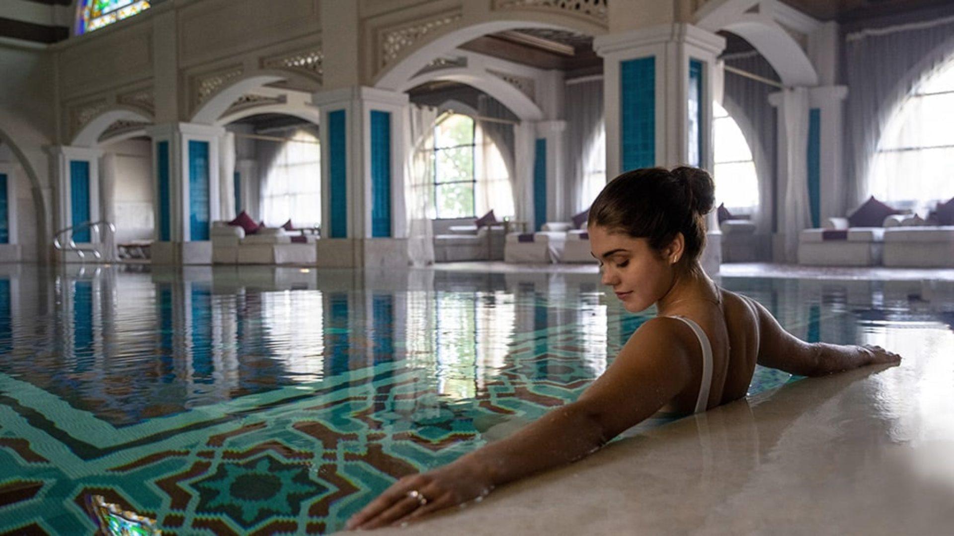 Woman in the pool at Talise Ottoman Spa at Jumeirah Zabeel Saray