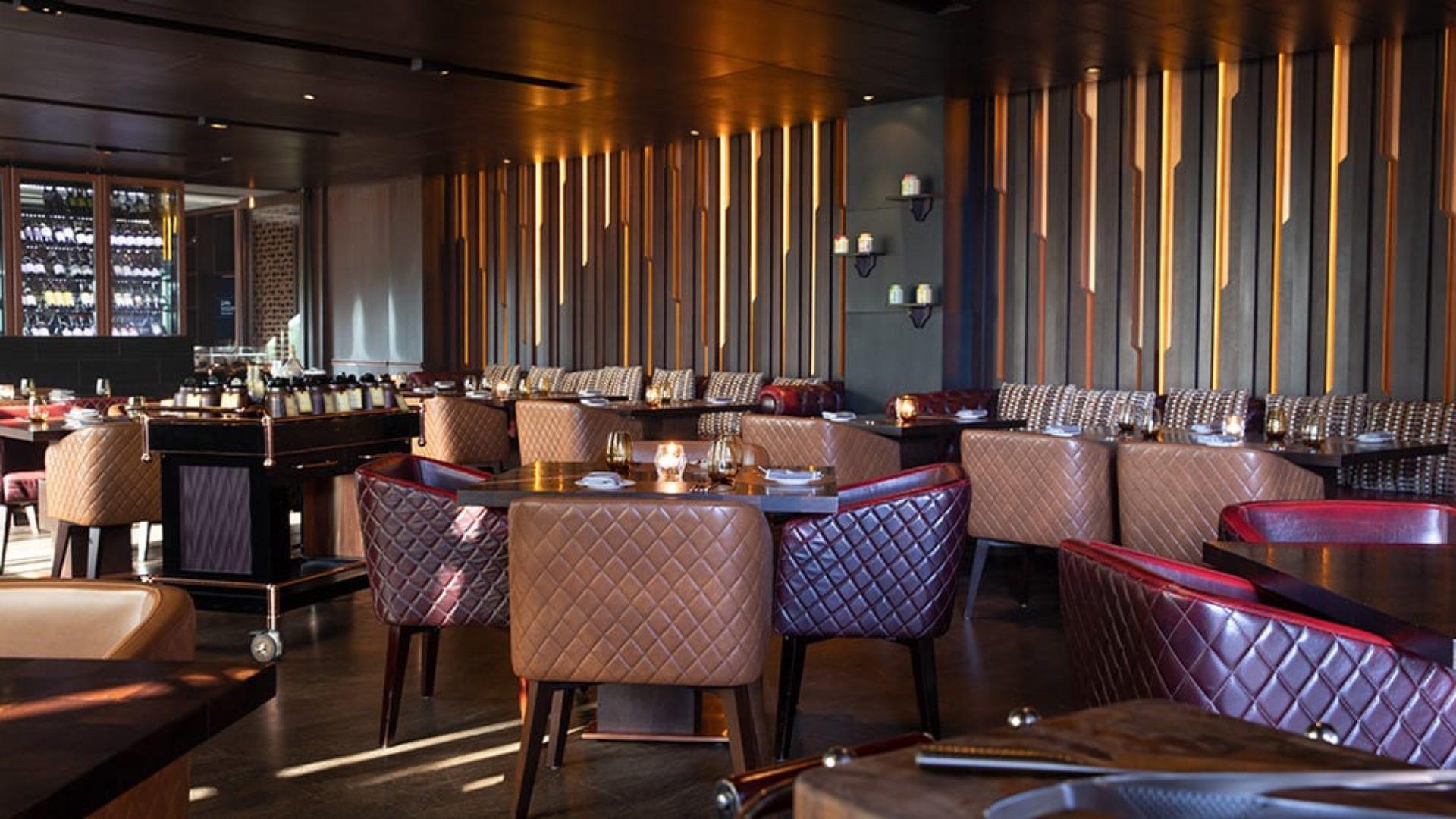 Indoor dining at The Rib Room at Jumeirah Zabeel Saray