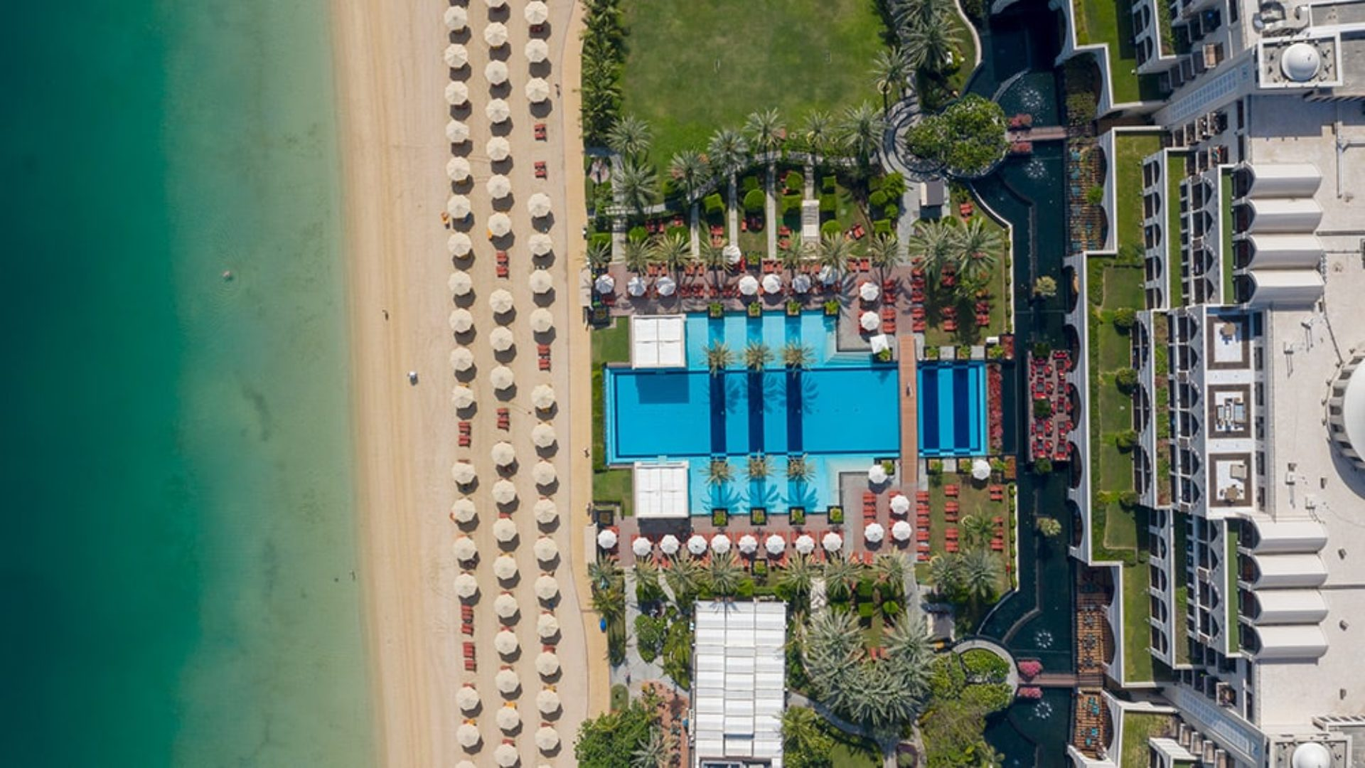 Aerial view of the pool and beach at Jumeirah Zabeel Saray