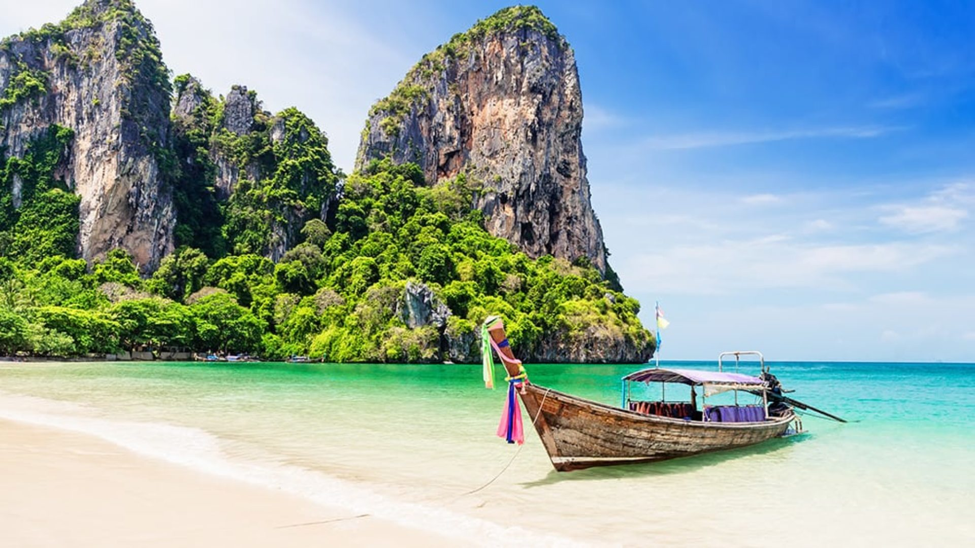 Long tail boat on the beach on a Thailand Multi-Centre