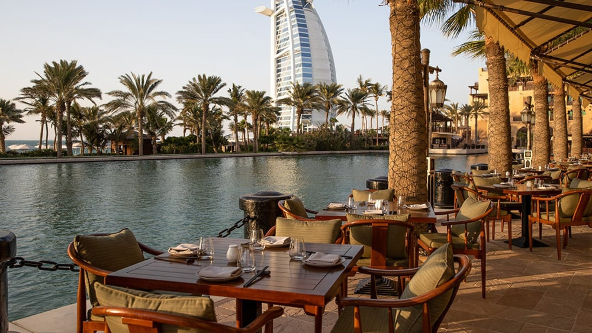 Outdoor terrace dining at sunset at Jumeirah Dar Al Masyaf