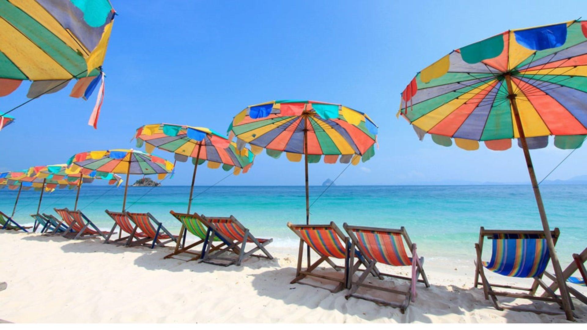 Beach chairs under umbrellas in Phuket on a Thailand Multi-Centre
