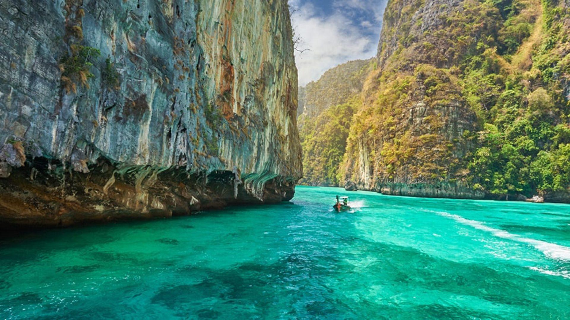Traditional Thai boat near limestone cliffs on a Thailand Multi-Centre