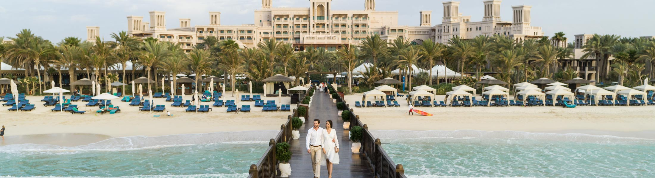 a Couple walking along the Pier at the Jumeirah Al Qasr