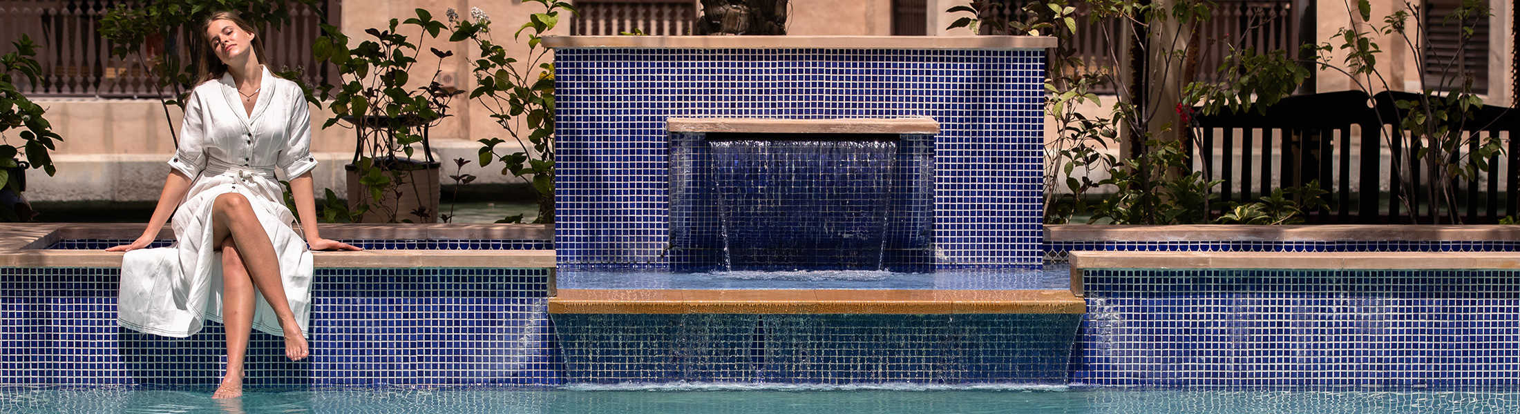 Woman in her Summerhouse pool at Jumeirah Dar Al Masyaf