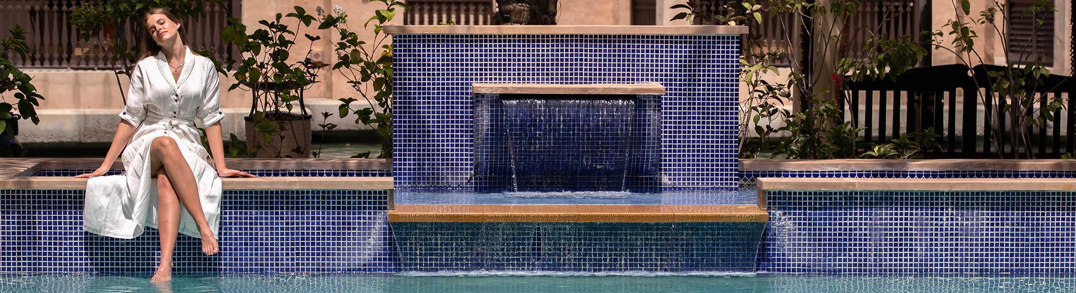 Woman in her Summerhouse pool at Jumeirah Dar Al Masyaf