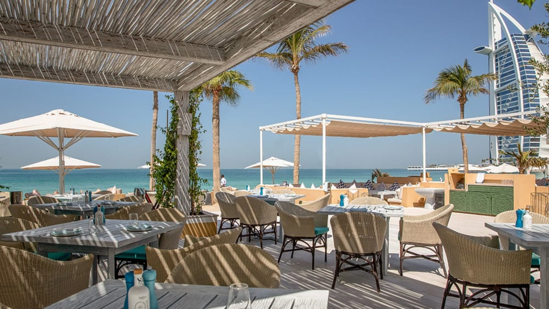 Outdoor terrace of Shimmers Restaurant at Jumeirah Mina A'Salam