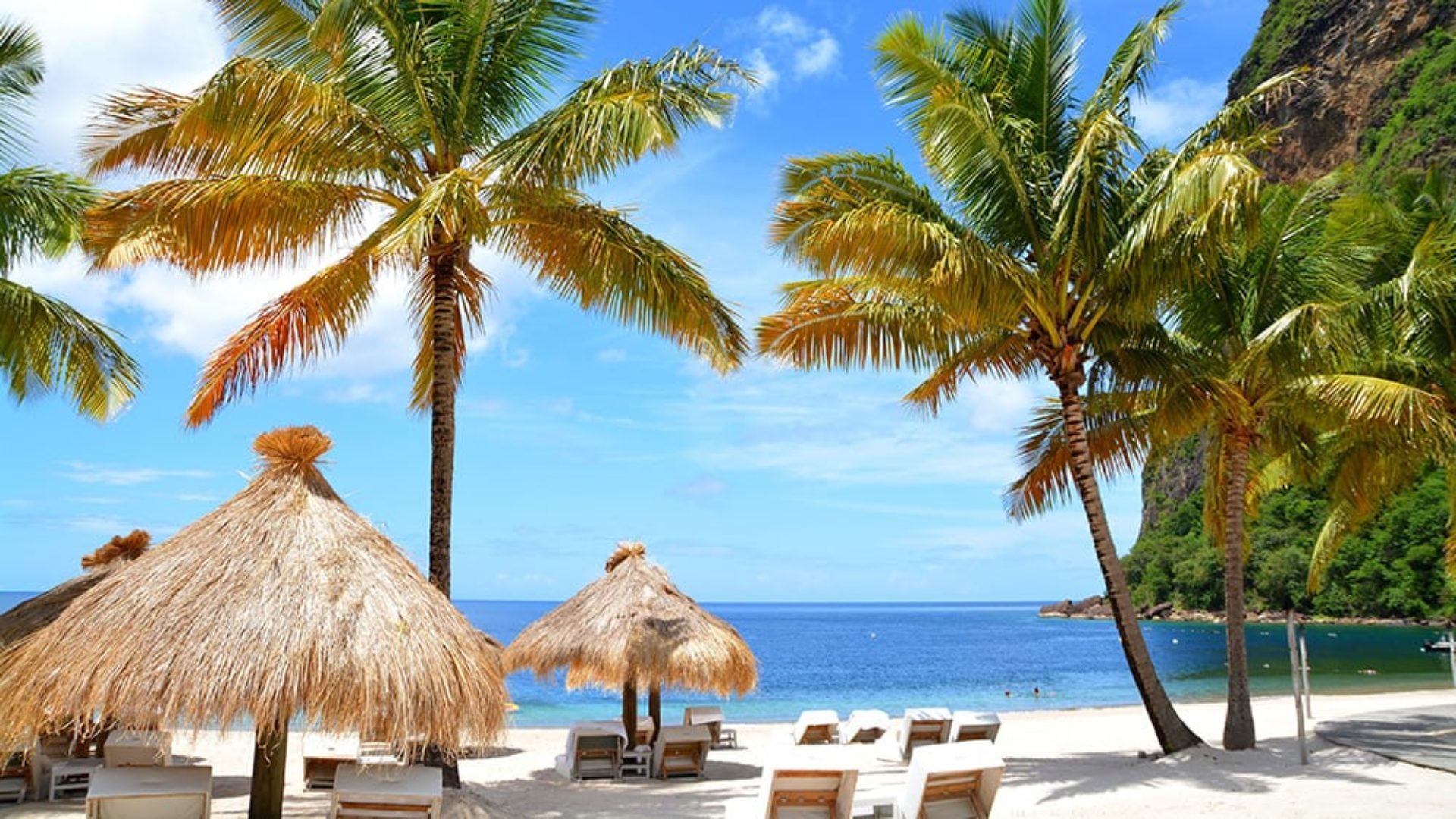Beach with sun loungers in St Lucia on a USA & Caribbean multi-centre