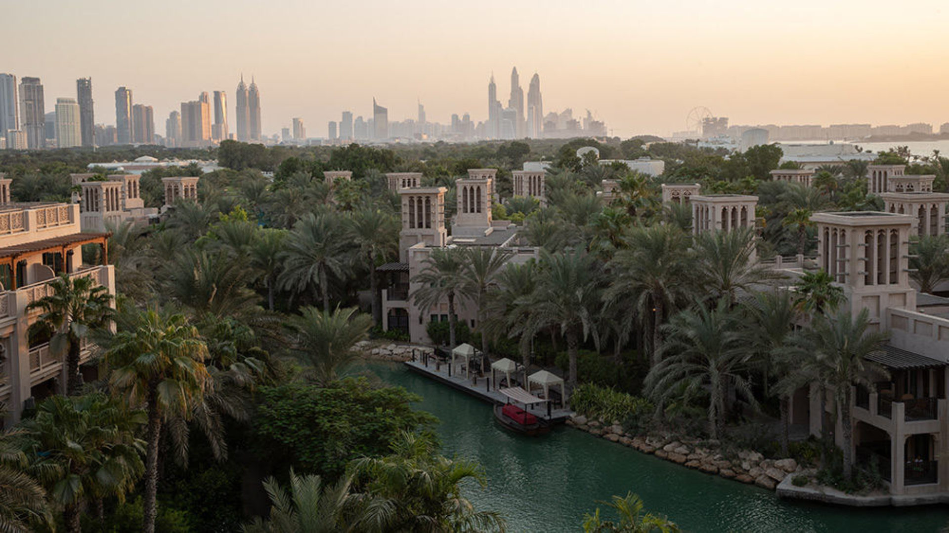 View of Dubai skyline at sunset from Jumeirah Dar Al Masyaf