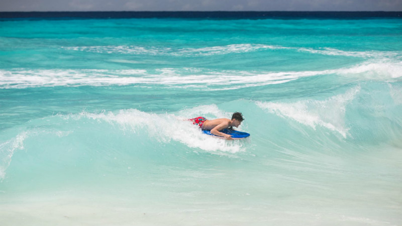 Surfing at the Turtle Beach by Elegants hotels beach