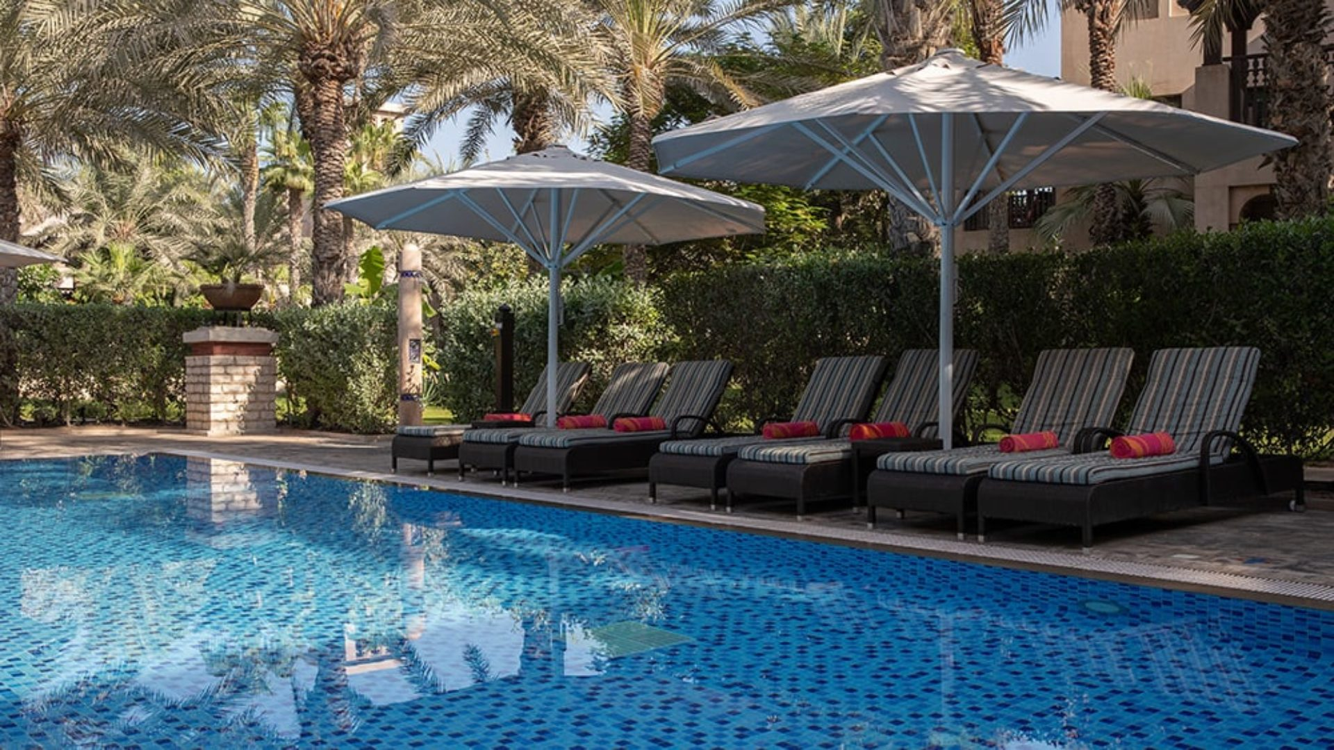 Shared pool with sun loungers at Jumeirah Dar Al Masyaf
