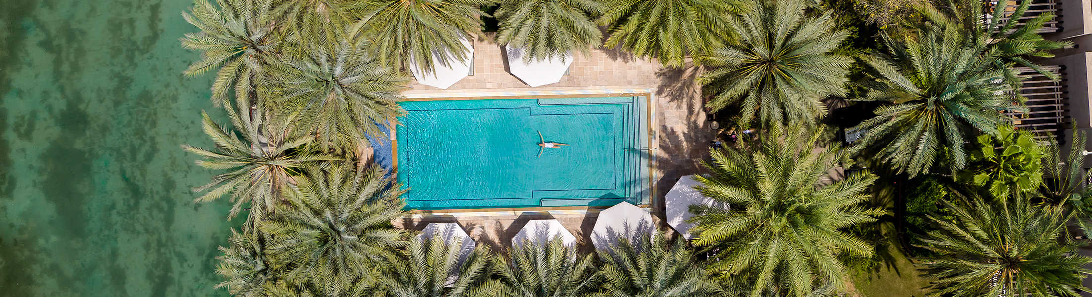 Aerial view of a private villa pool at Jumeirah Dar Al Masyaf