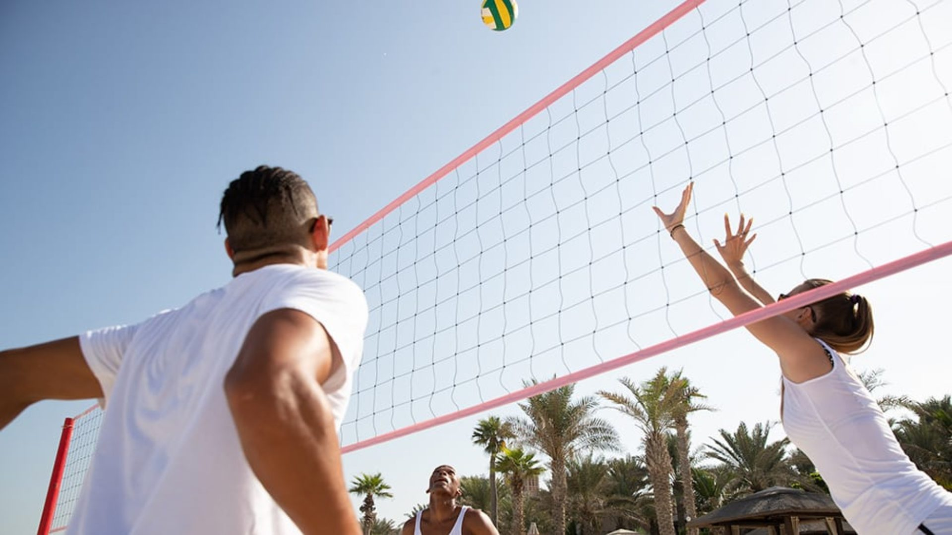 People playing beach volleyball at Jumeirah Mina A'Salam