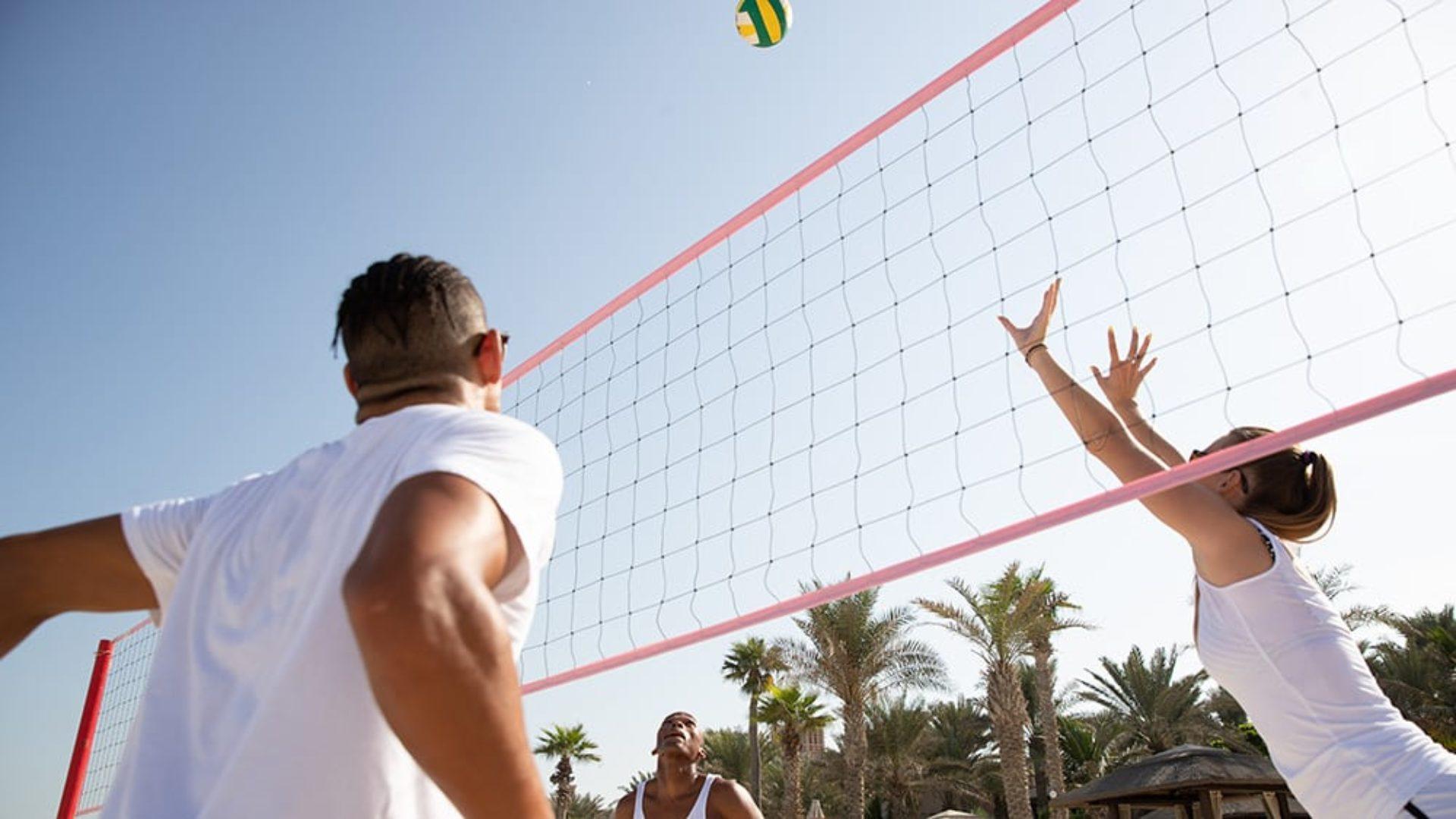 People playing beach volleyball at Jumeirah Mina A'Salam