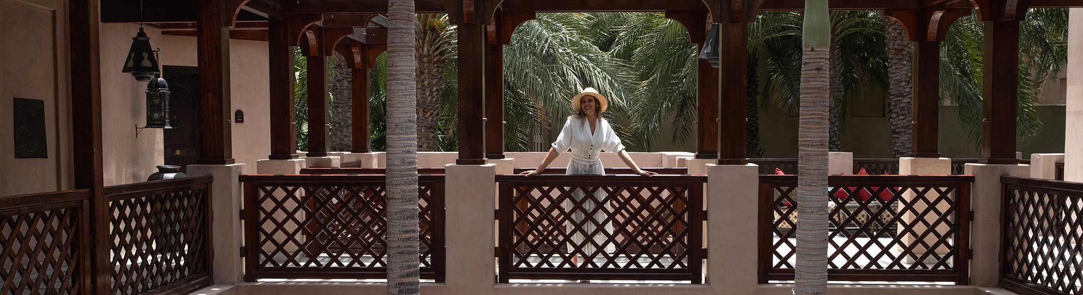 Woman on the elevated walkway at Jumeirah Dar Al Masyaf