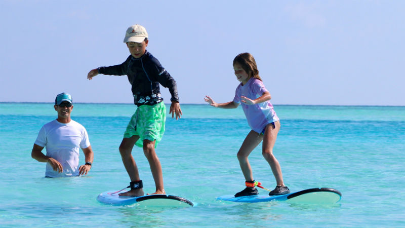 learning to surf at Anantara Dhigu Resort, Maldives