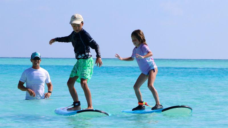 learning to surf at Anantara Dhigu Resort, Maldives