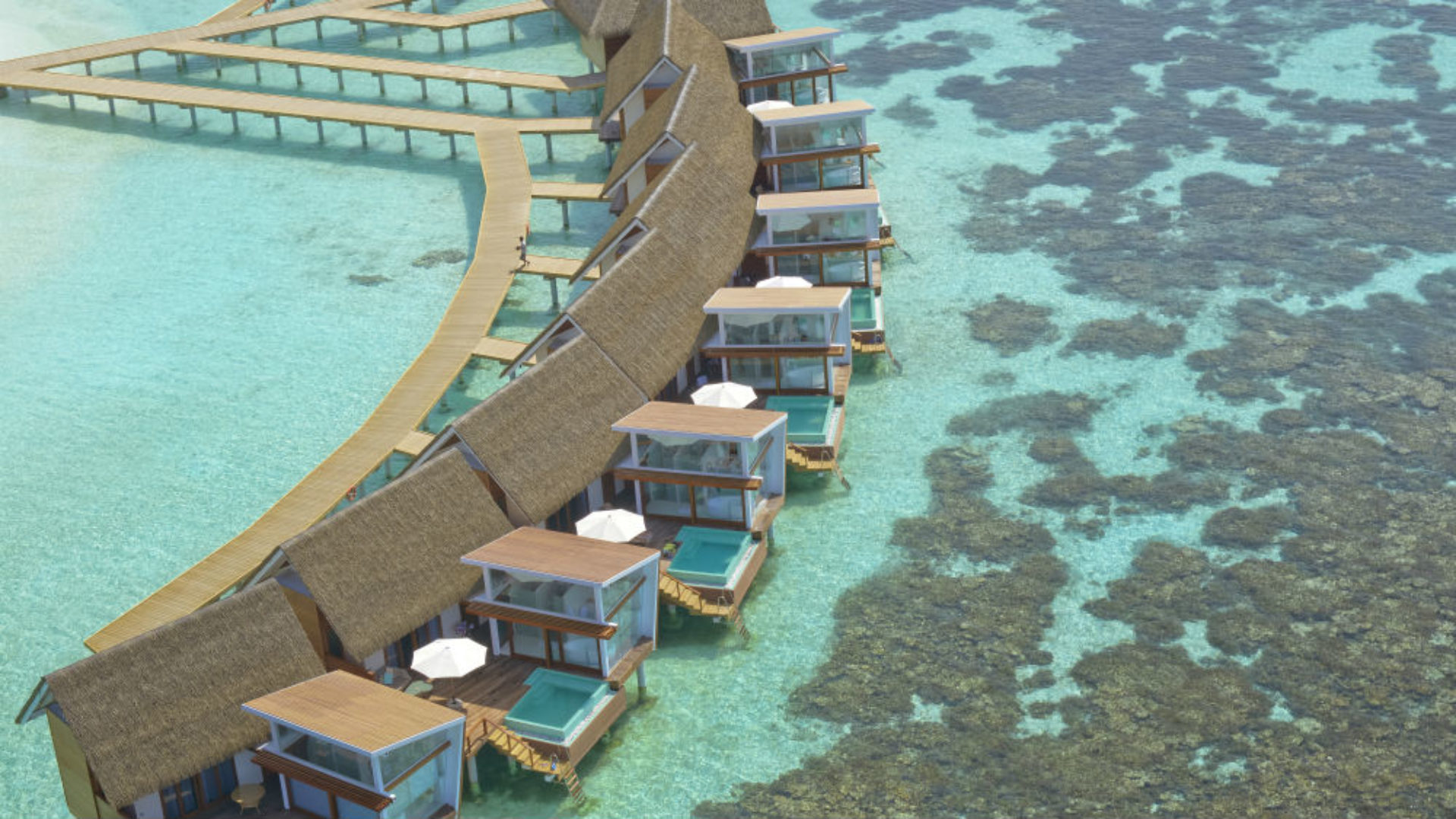 Aerial view of the overwater villas at Kandolhu Resort