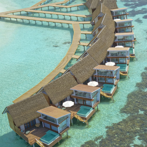 Aerial view of overwater villas at Kandolhu Resort