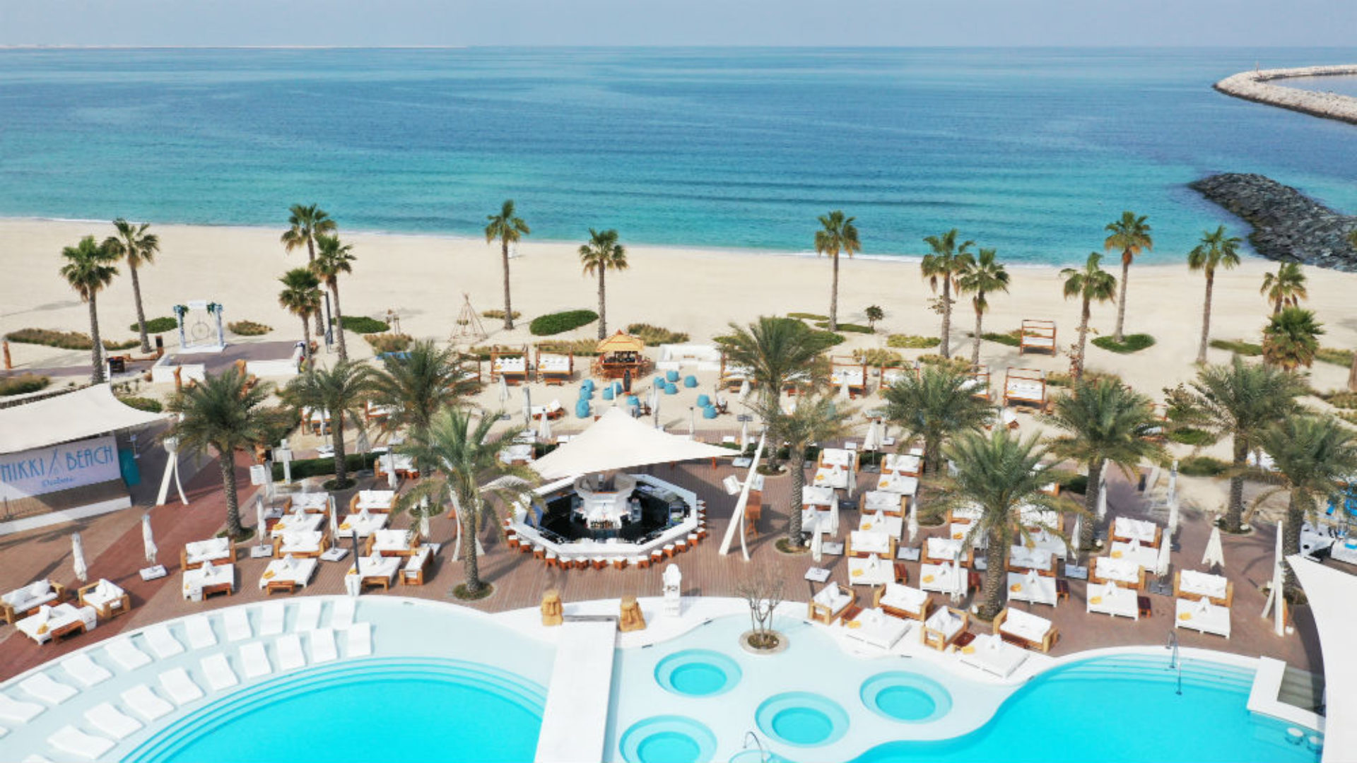 Aerial view of the pool & beach at the Beach Club at Nikki Beach Resort & Spa