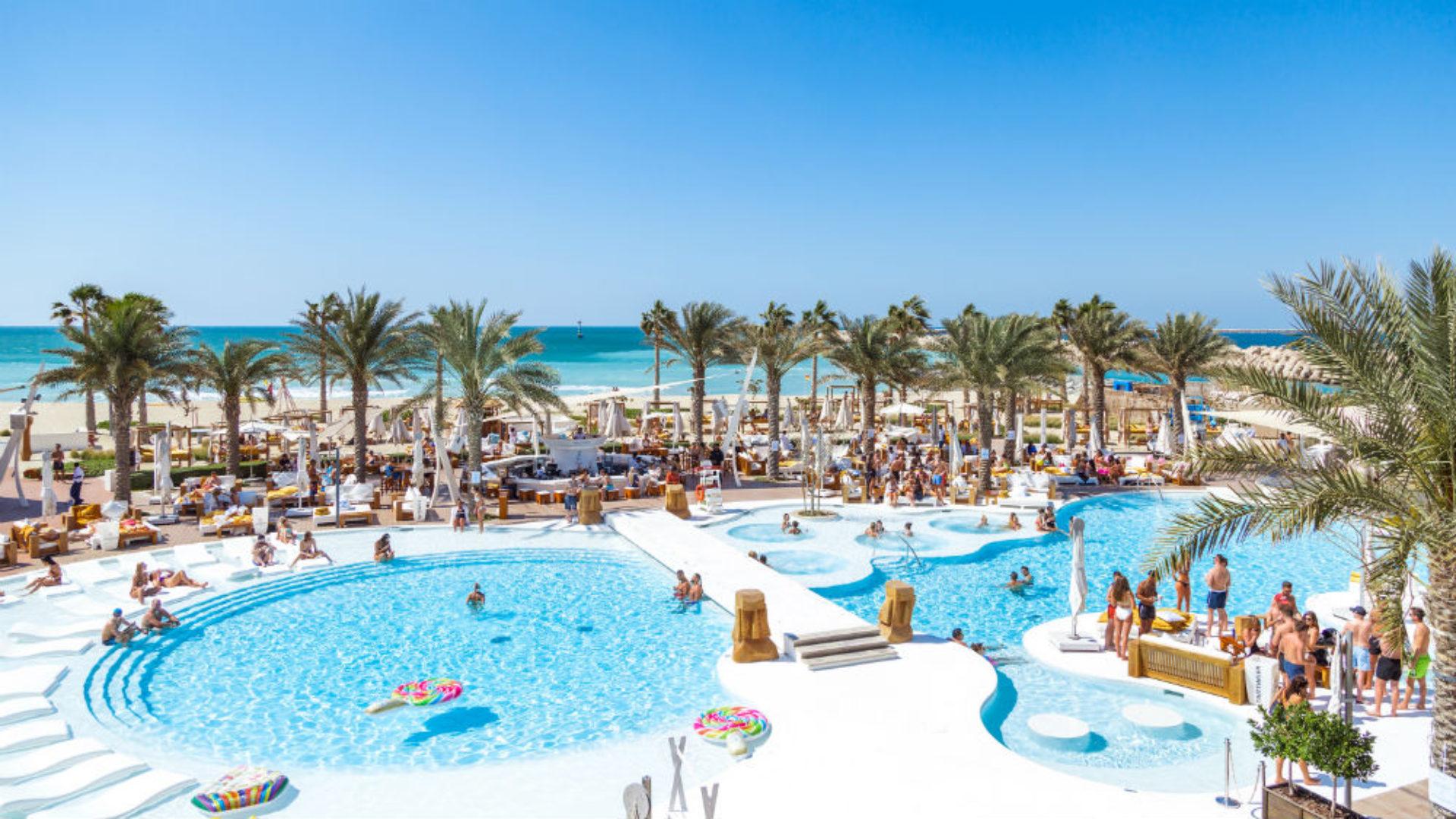 Pool & beach at the Beach Club at Nikki Beach Resort & Spa