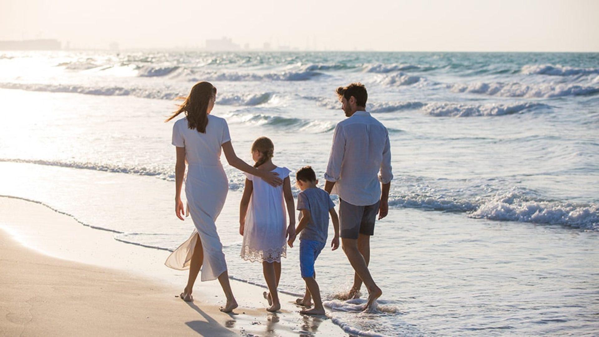 Family on the beach at Jumeirah at Saadiyat Island