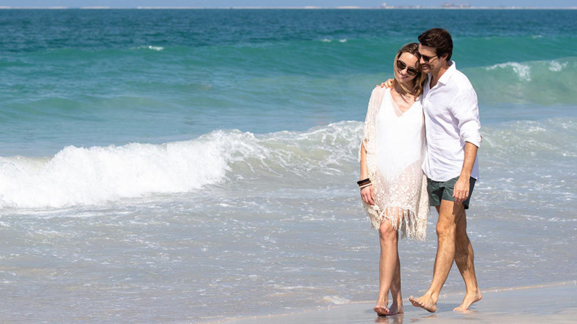 Couple walking on the beach at Jumeirah Beach Hotel