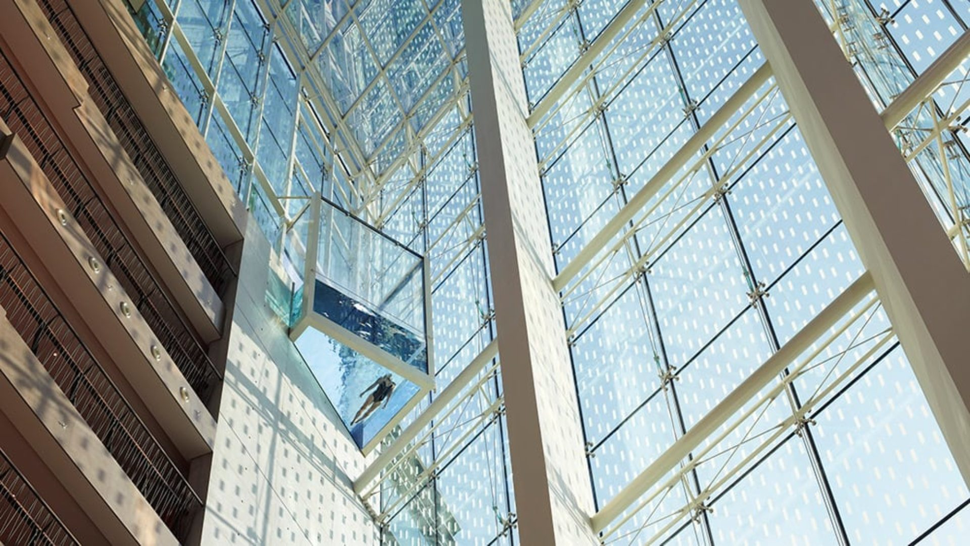 Swimming pool cantilevered over the lobby at Jumeirah Creekside