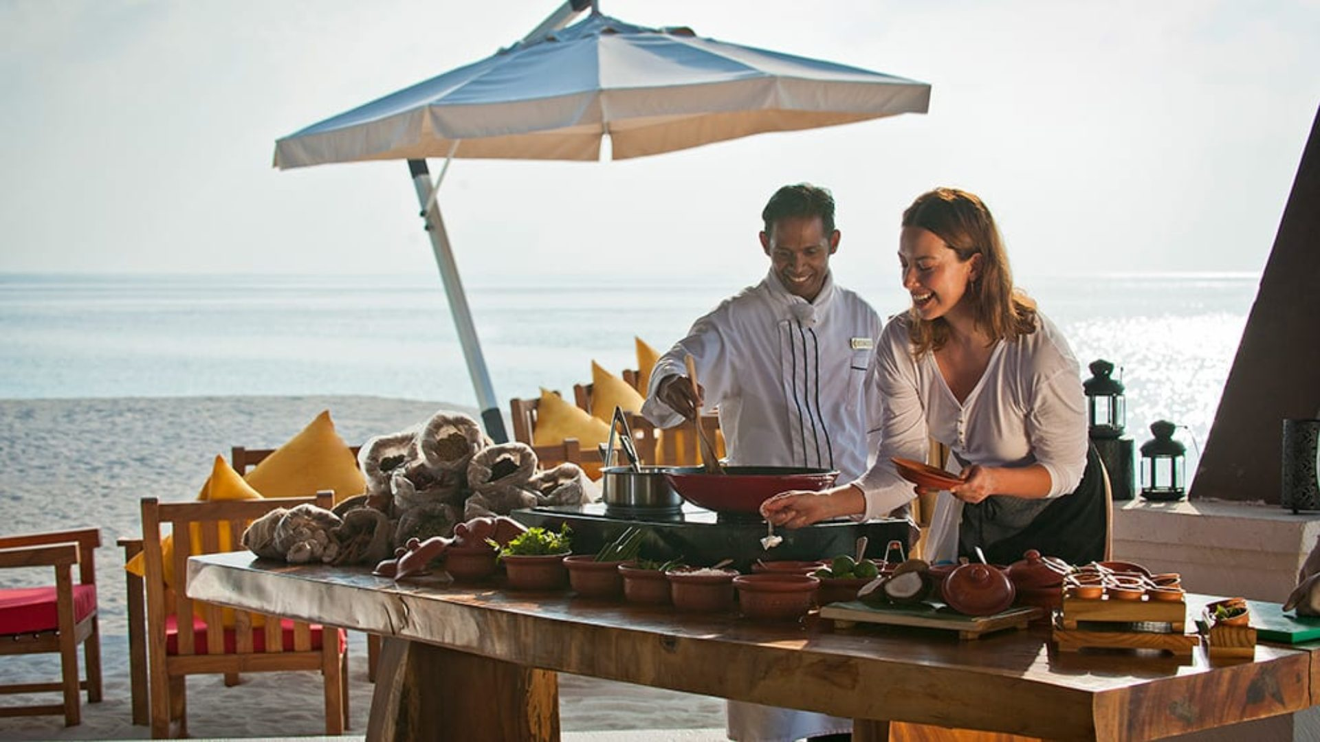 Woman doing a cooking class with a chef at Jumeirah Vittaveli