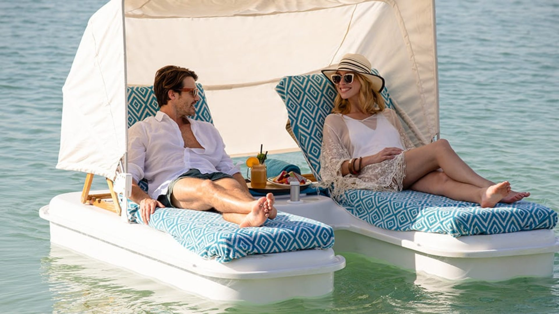 Couple on floating cabana at Jumeirah Beach Hotel