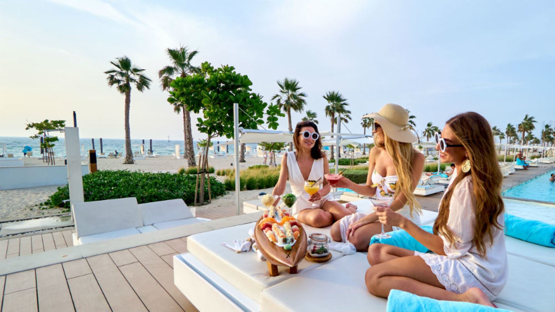 Girlfriends on a sun lounge at Nikki Beach Resort & Spa