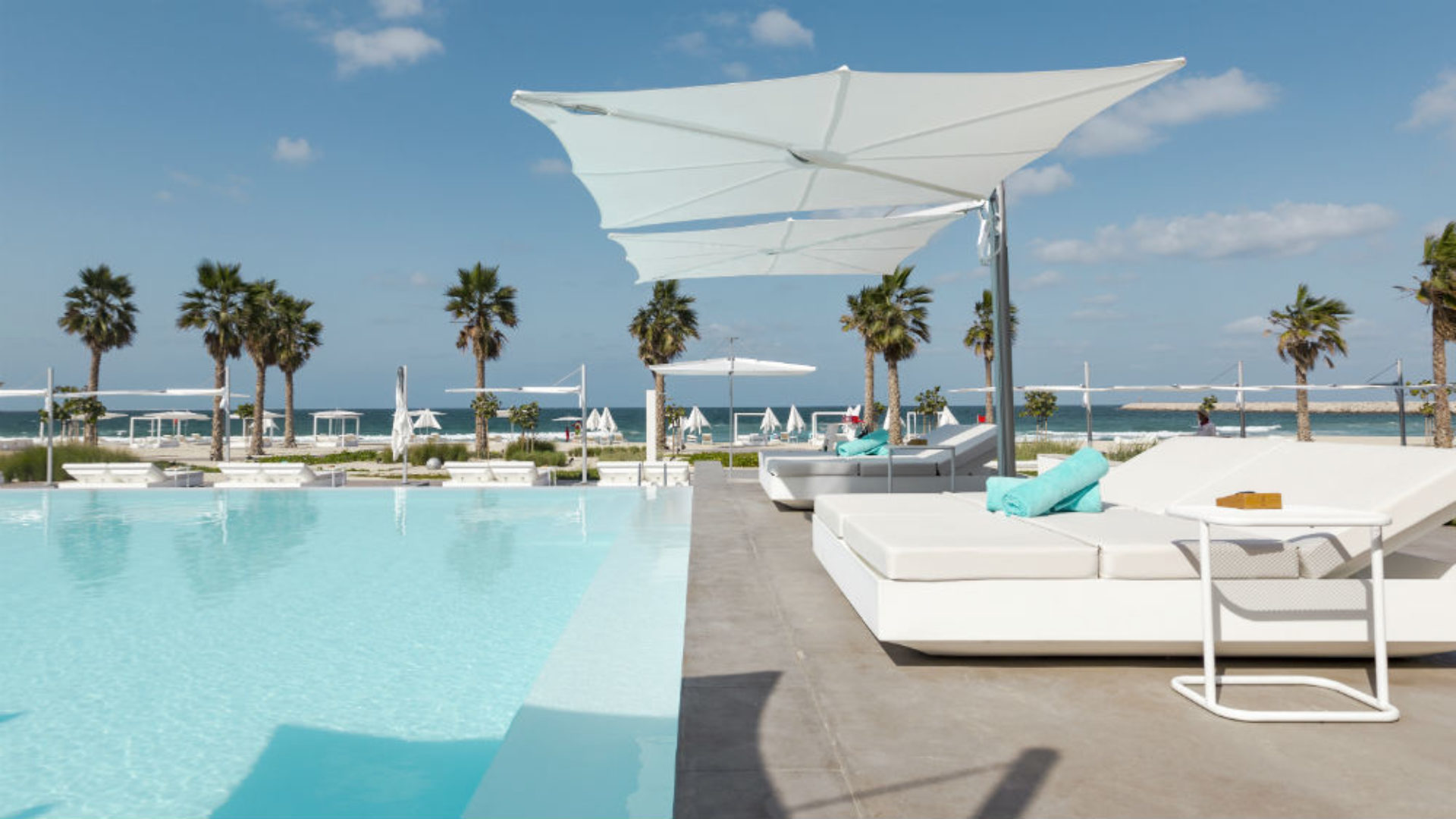 Main pool and sun loungers at Nikki Beach Resort & Spa