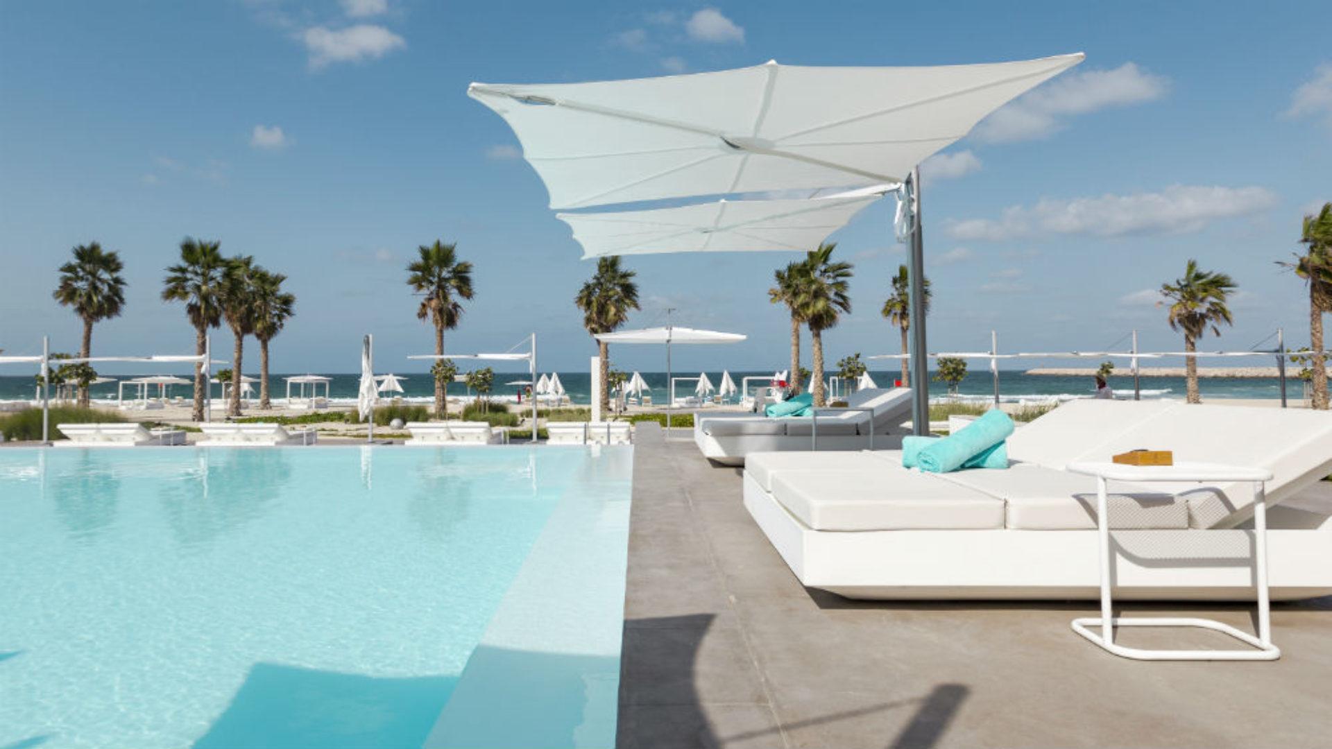 Main pool and sun loungers at Nikki Beach Resort & Spa