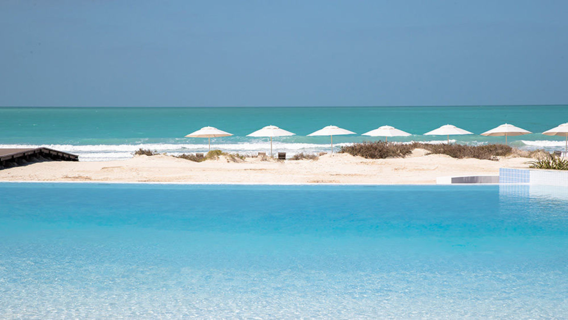 Infinity pool and beach at Jumeirah at Saadiyat Island