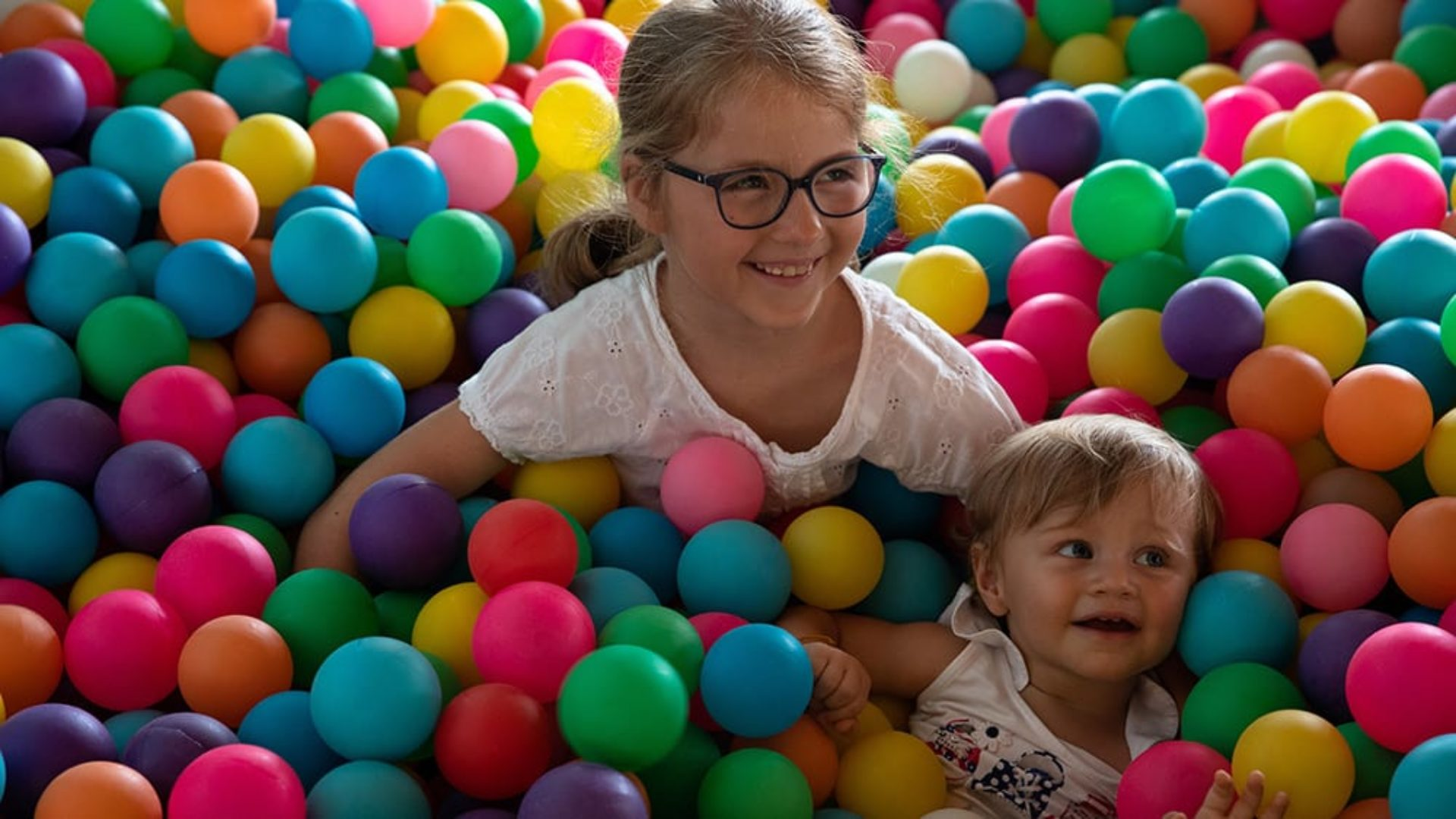 Children in a ball pit in the kids club at Jumeirah Vittaveli
