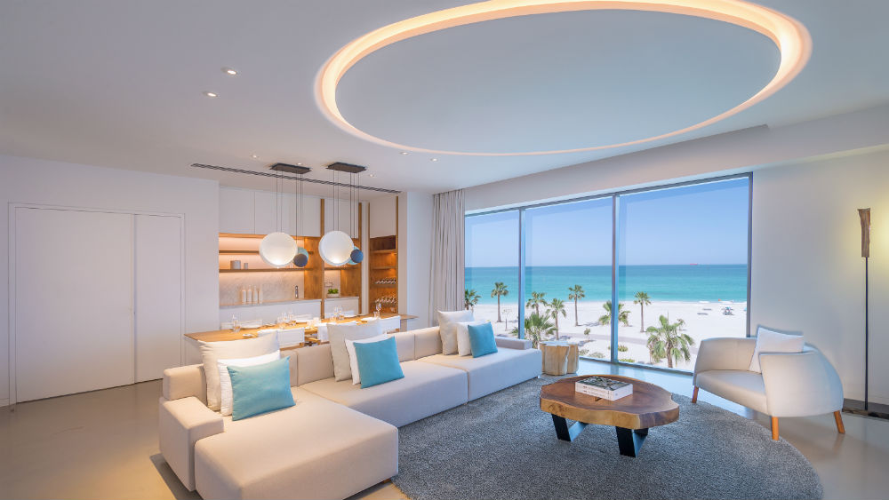 Luux suite living room beach view at the Nikki Beach Resort & Spa Dubai