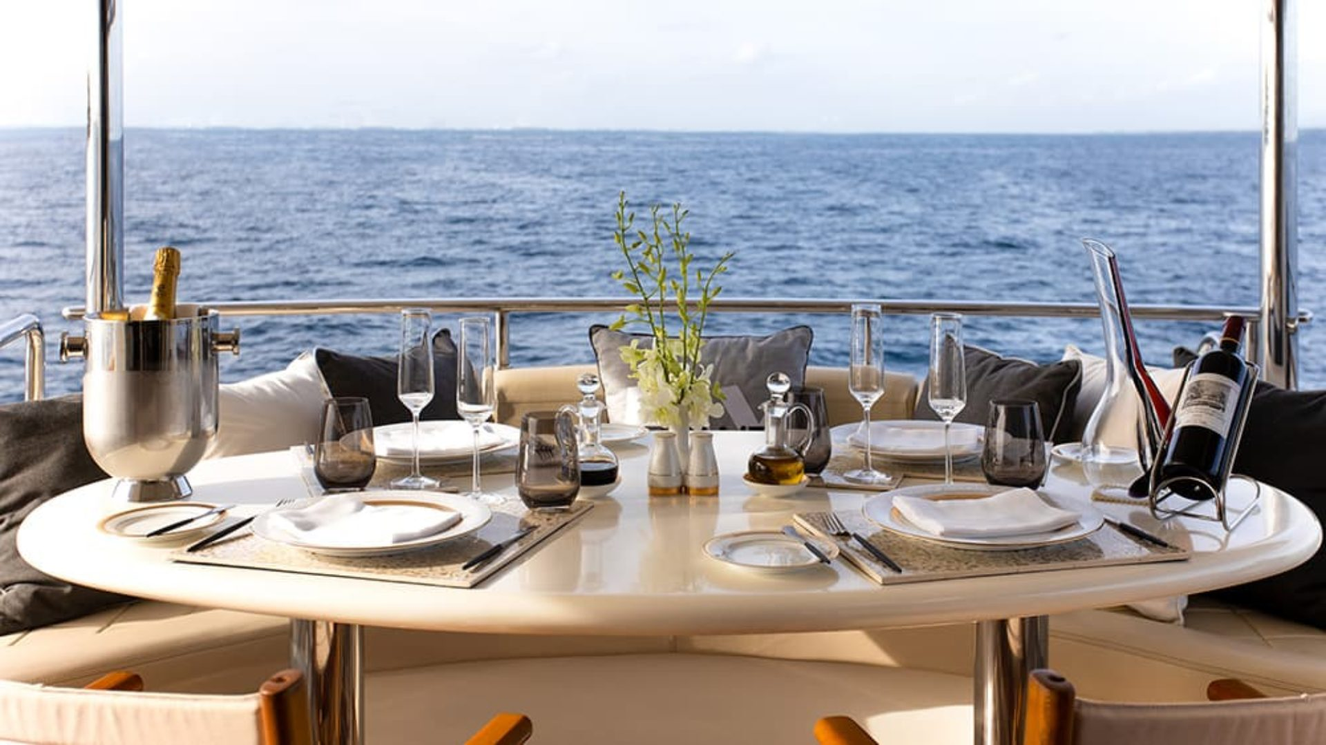 Private dining on the deck of the MY Vittaveli superyacht at Jumeirah Vittaveli