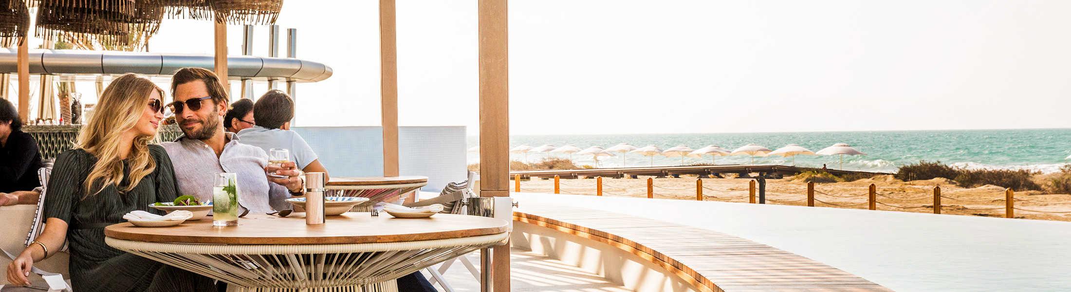Couple at Mare Mare Restaurant at Sunset at Jumeirah at Saadiyat Island