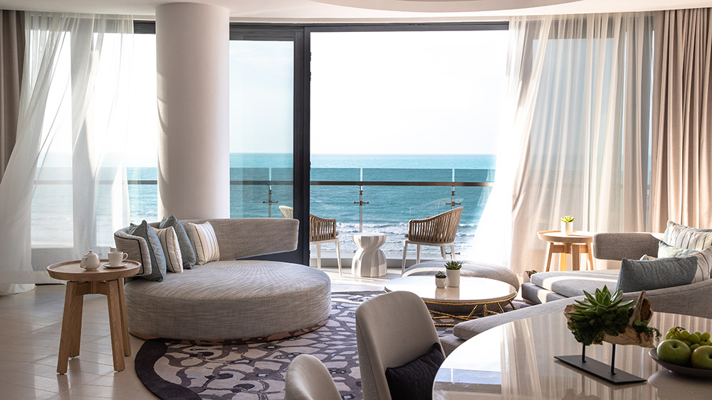 Living room with ocean view of the Panoramic Suite at Jumeirah at Saadiyat Island