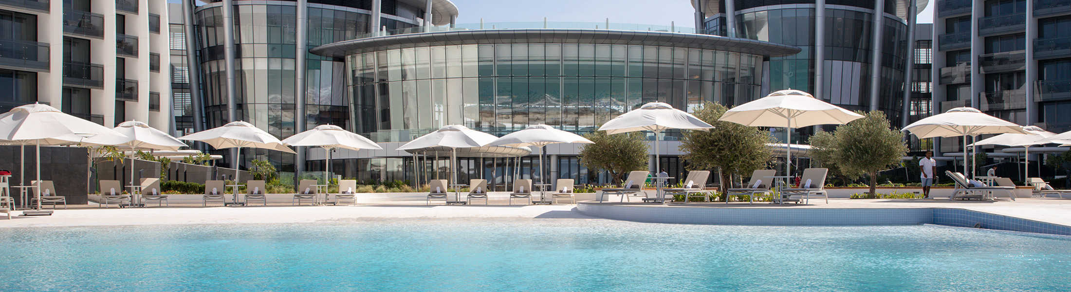 Outdoor pool and sun loungers at Jumeirah at Saadiyat Island
