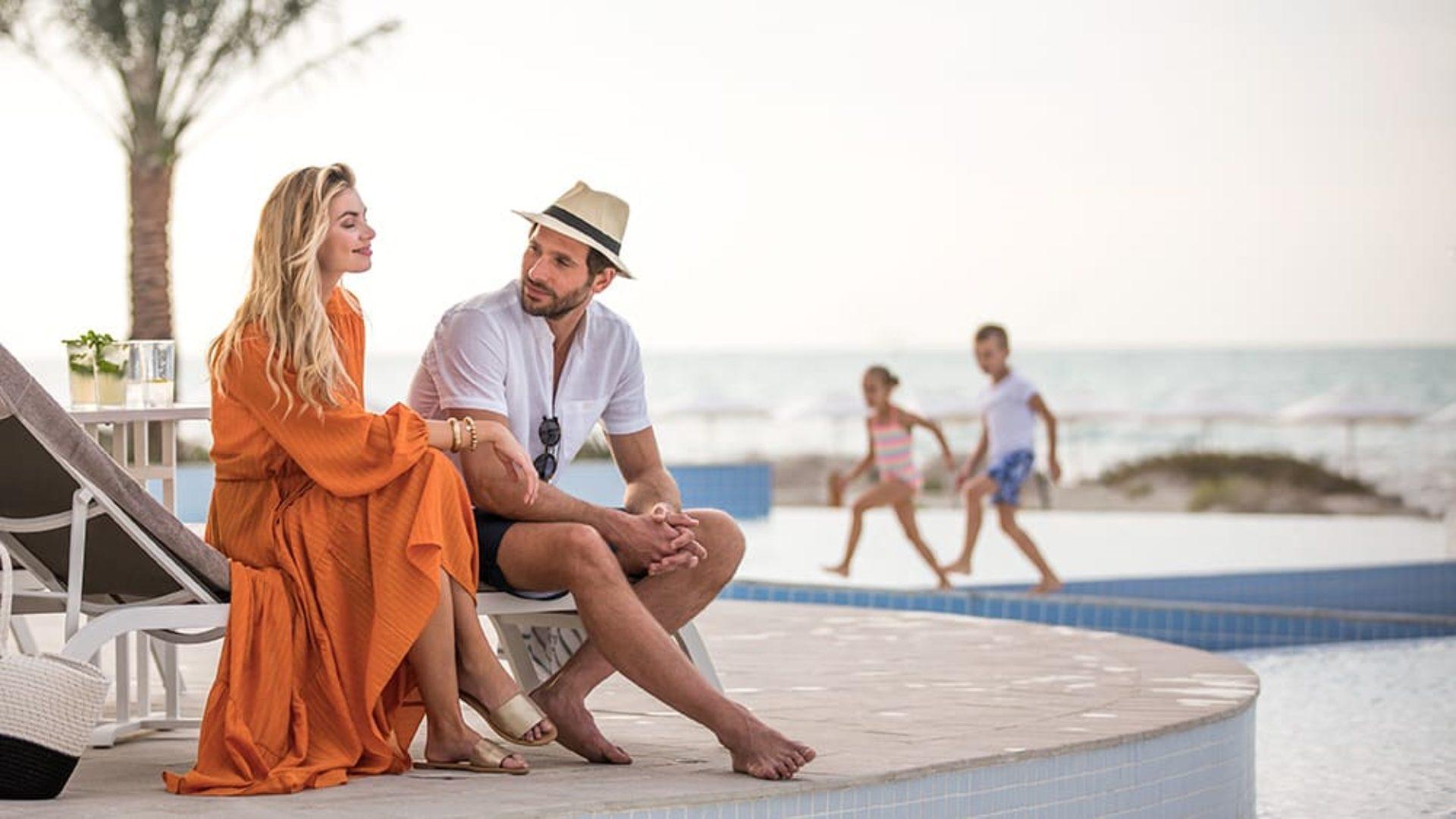 Family by the pool at Jumeirah at Saadiyat Island