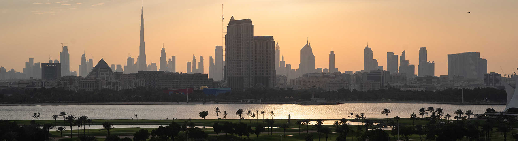 Sunset over the golf course and Dubai from Jumeirah Creekside Hotel
