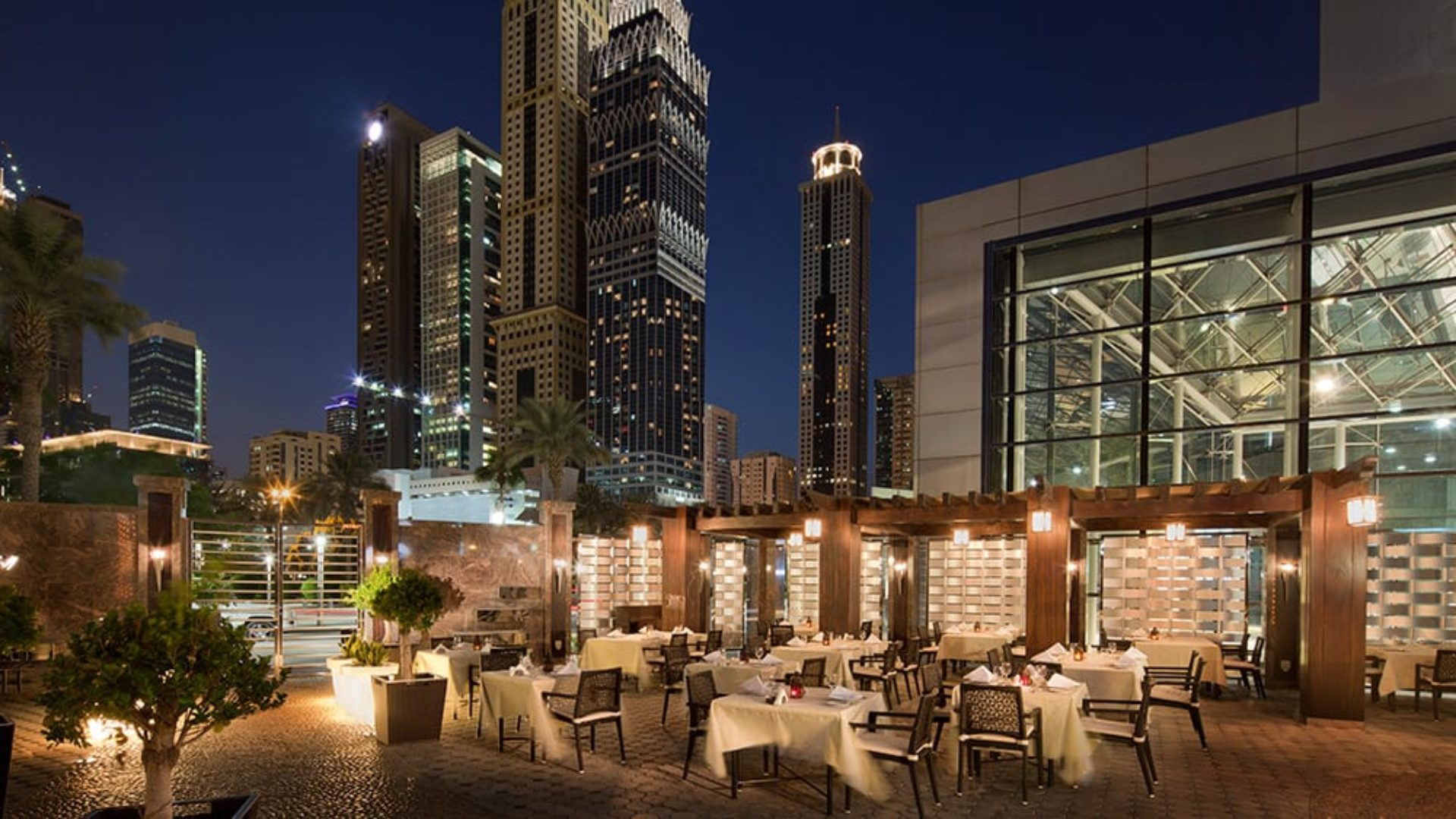 Outdoor dining terrace at Al Nafoorah at Jumeirah Emirates Towers
